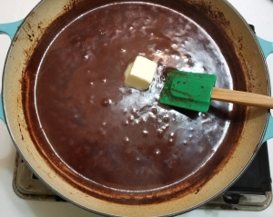 Melting butter into tequila sauce